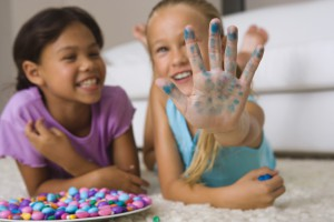 Children playing with stained hands